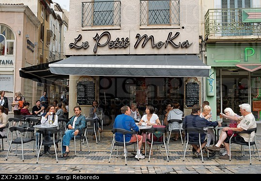 Le Petit Moka bar restaurant at Town hall square. Narbonne. Pedestrian shopping street in old city central Narbonne. South of France. The ancient town...
